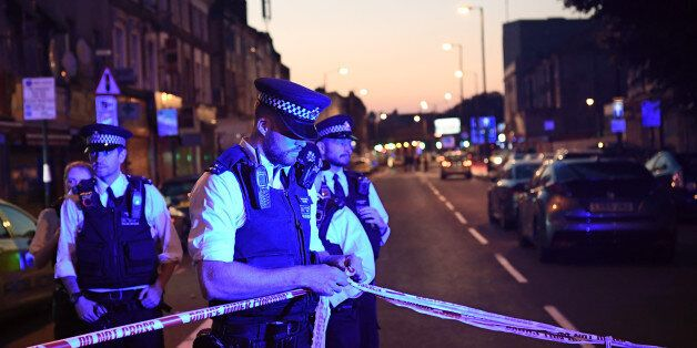 LONDON, ENGLAND - JUNE 19: Police officers guard a road leading to Finsbury Park Mosque after an incident...