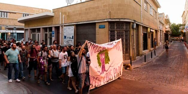 Turkish-Cypriot and Greek-Cypriot protestors take part in a demonstration calling for the unification...
