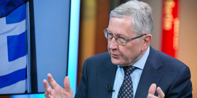 Klaus Regling, chief executive officer of the European Financial Stability Facility (EFSF), gestures...