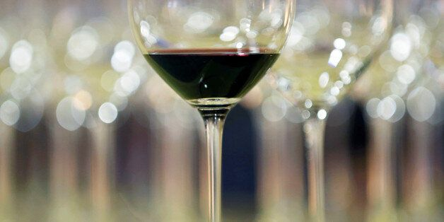 A glass of red wine is displayed at the Chateau La Louviere during the start of the Primeurs, a week...