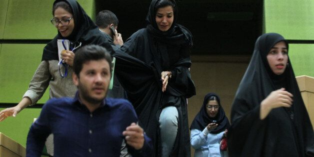 Women are seen inside the parliament during an attack in central Tehran, Iran, June 7, 2017. TIMA via...