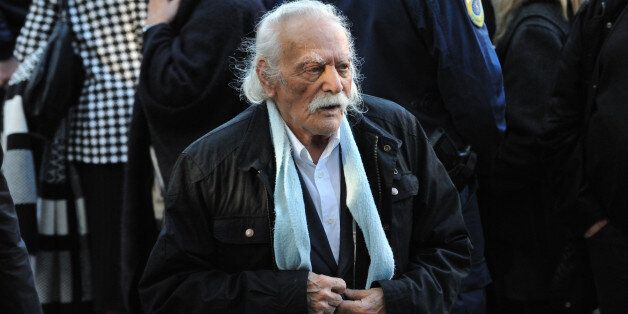 ATHENS, GREECE - NOVEMBER 22: World War II resistance hero Manolis Glezos leaves Aghios Dimitrios church...