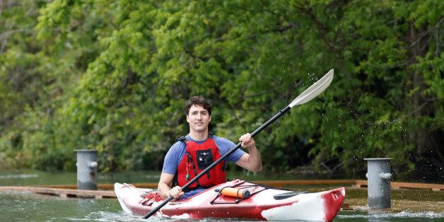 Canada's Prime Minister Justin Trudeau paddles a kayak to mark World Environment Day on the Niagara River,...