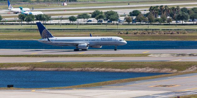 Orlando, USA - April 23, 2012: Boeing 757 United Airlines taxiing on Orlando International Airport on...