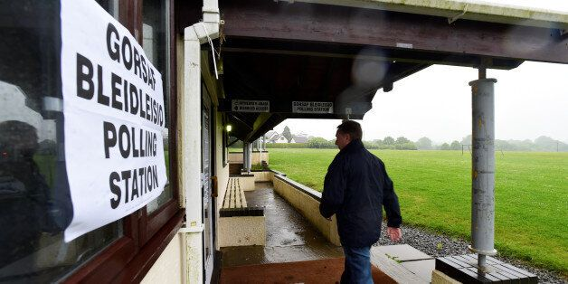A voter arrives at St Florence's Village Hall which is being used as a polling station in Wales, Britain,...