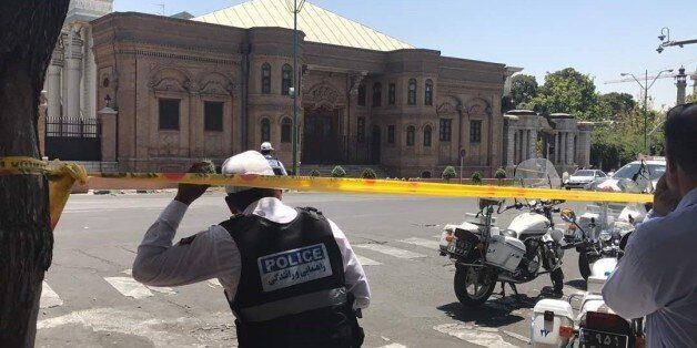 TEHRAN, IRAN - JUNE 7: Police take security measures at the scene after gunmen opened fire at Irans parliament...