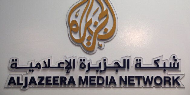 The logo of Al Jazeera Media Network is seen during the annual MIPCOM television programme market in...