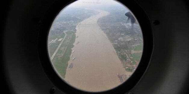 The Yangon river is seen from the window of a Thai military plane May 7, 2008. Military helicopters dropped...