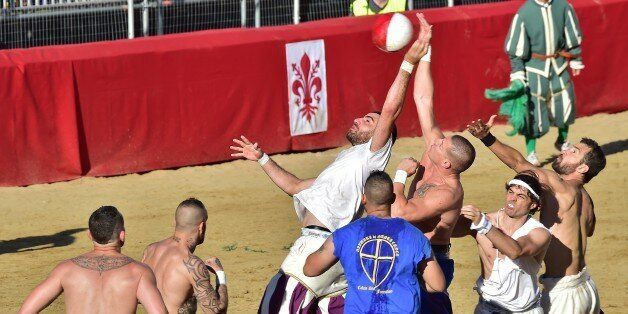 FLORENCE, ITALY - JUNE 11: Players take part in a game of the Calcio Storico Fiorentino ('Historic Florentine...