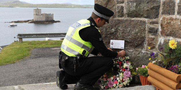 BARRA, UNITED KINGDOM - JUNE 5: Flowers are laid by an officer from Police Scotland on behalf of the...