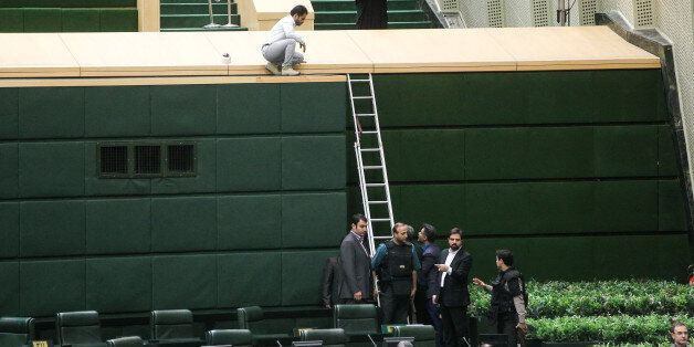 A picture taken on June 7, 2017 shows policemen deploying in the main hall of Iranian parliament to protect...