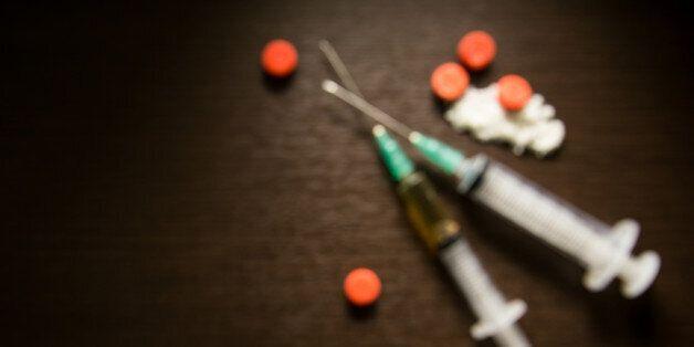 Background blur Drug syringe and cooked