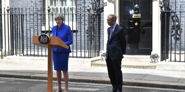 Britain's Prime Minister and leader of the Conservative Party Theresa May, (L), accompanied by her husband...