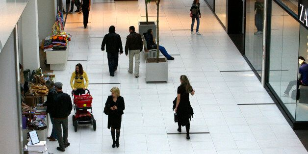 People walk in the newly-opened Riga Plaza shopping center in Riga April 8, 2009. The latest data released...