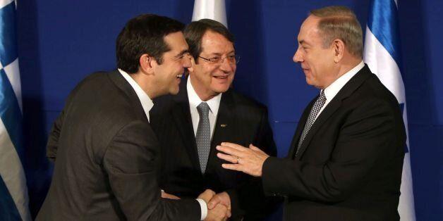 Israeli Prime Minister Benjamin Netanyahu (R), Greek Prime Minister Alexis Tsipras (L) and Cypriot President...