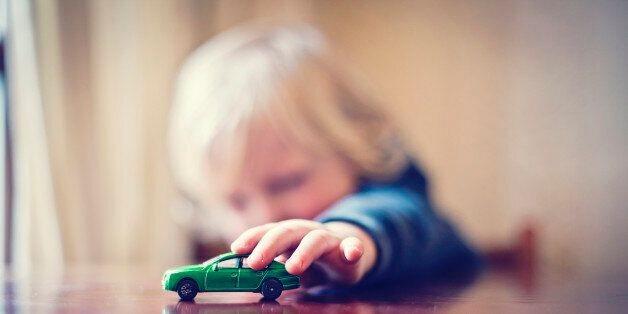 Little boy playing with toy