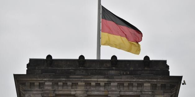The German flag flies at halfmast at the Reichstag building that houses Germany's Bundestag lower house...