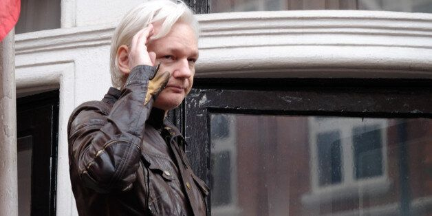 Julian Assange speaks to the media from the balcony of the Embassy Of Ecuador on May 19, 2017 in London,...