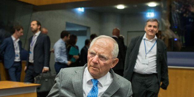 Wolfgang Schaeuble, Germany's finance minister, center, arrives ahead of Euclid Tsakalotos, Greece's...