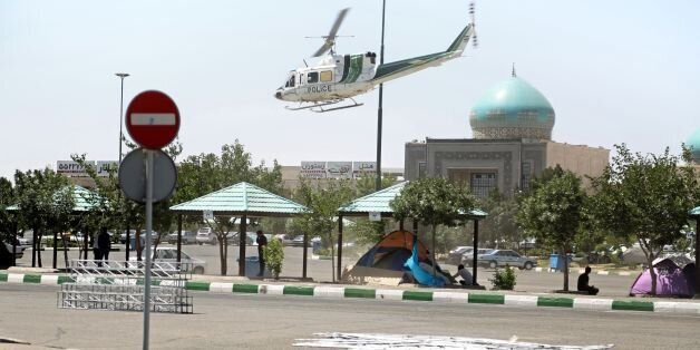 A picture taken on June 7, 2017, shows a police helicopter flying around outside the mausoleum of Ayatollah...