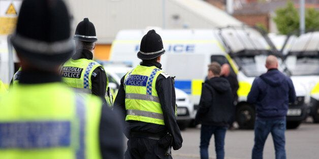 CARDIFF, WALES - APRIL 28: A group of police watch on as Newcastle United fans arrive before kick off...