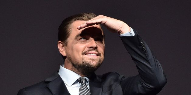 U.S. actor Leonardo DiCaprio looks on prior to speaking on stage during the Paris premiere of the documentary