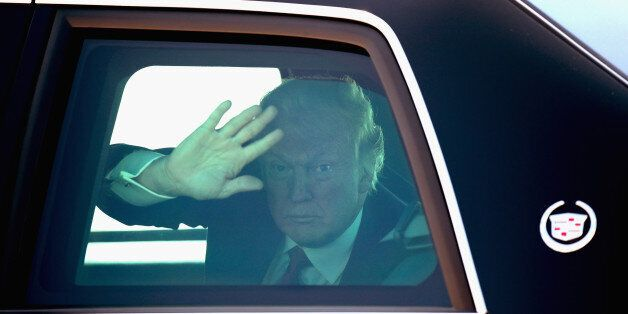 MILWAUKEE, WI - JUNE 13: U.S. President Donald Trump waves to guests as he leaves General Mitchell International...