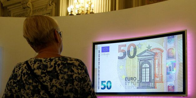 A visitor looks at a video with the new 50 Euro banknote at the Bank of Italy headquarters in Rome, Italy...