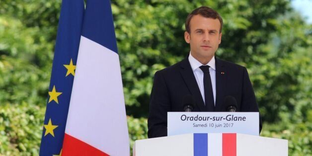 French President Emmanuel Macron (C) delivers a speech during a commemoration ceremony marking the 73rd...