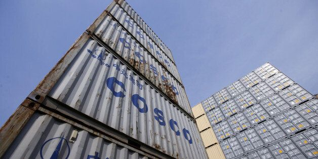 Containers from China Ocean Shipping Company (COSCO) are pictured at a port in Shanghai, China, February...