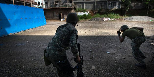 MARAWI CITY, PHILIPPINES - MAY 30: Filipino soldiers engage in a firefight with ISIS-linked militants,...