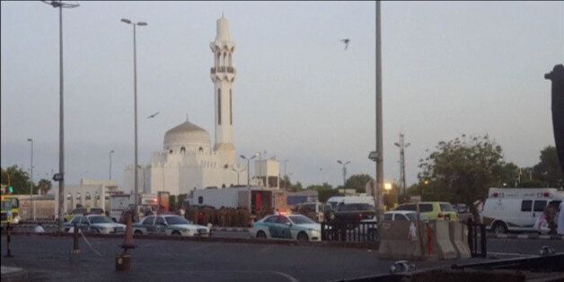 General view of security personnel in front of a mosque as police stage a second controlled explosion,...
