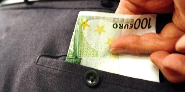 (AUSTRALIA & NEW ZEALAND OUT) 100 euro being taken out from the back pocket of trousers, 1 September...