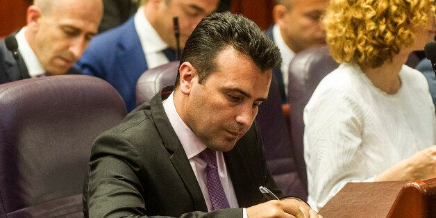The new Prime-minister of Macedonia, Zoran Zaev, signs an oath in the Macedonian Parliament building...