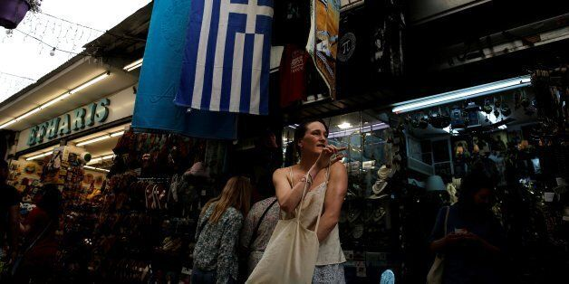 A woman exits a shop at the Monastiraki district in Athens, Greece, May 16, 2017. REUTERS/Costas