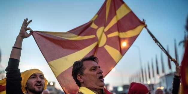 People protest in Skopje on March 3, 2017, against a deal between the Social democrats and the Albanian...