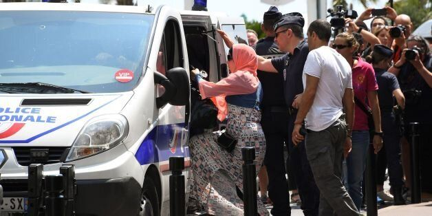 A woman enters a Police van after being arrested by Police on May 26, 2017 outside the luxury Martinez...