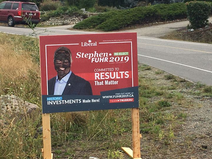 Photo of a defaced election sign for Kelowna—Lake Country Liberal candidate Stephen Fuhr.