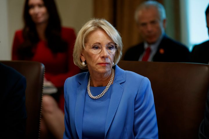 Education Secretary Betsy DeVos listens during a Cabinet meeting in the Cabinet Room of the White House in Washington.