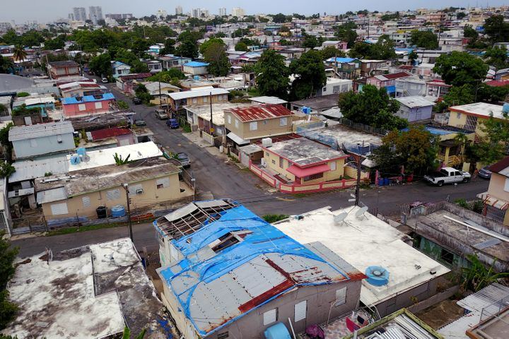 Roughly 30,000 homes in Puerto Rico still are sheltered in part by blue tarps federal officials gave out after 2017's Hurrica