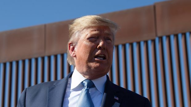 US President Donald Trump visits the US-Mexico border fence in Otay Mesa, California on September 18, 2019. (Photo by Nicholas KAMM / AFP)        (Photo credit should read NICHOLAS KAMM/AFP/Getty Images)