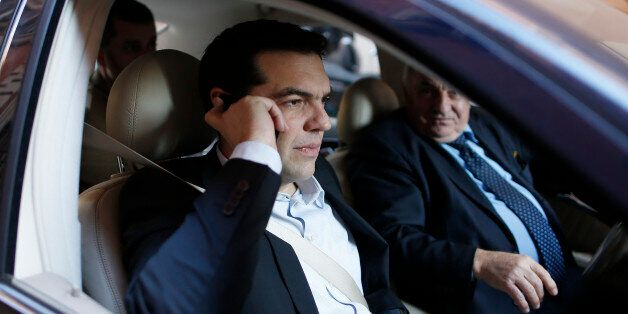 Greek radical left unified party President Alexis Tsipras (L) talks on his mobile phone as he arrives...
