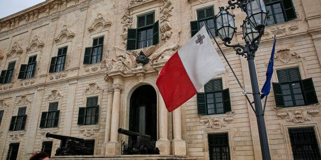 Canons and a Maltese flag sit on display outside the Auberge de Castille in Valletta, Malta, on Wednesday,...