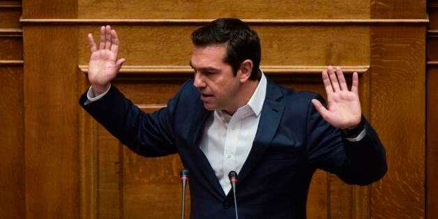 Greek Prime Minister Alexis Tsipras gestures as he delivers a speech during a parliamentary session in...