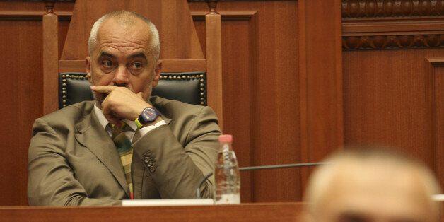 Albania's Prime Minister Edi Rama (L) listens to Ilir Meta, newly elected President of Albania holding...