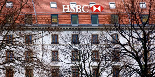 A HSBC logo sits on the rooftop of the building that houses HSBC Holdings Plc's private banking unit...