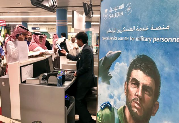 Passengers talk to an airline employee at Saudi Arabia's Abha airport, after it was attacked by Yemen's...