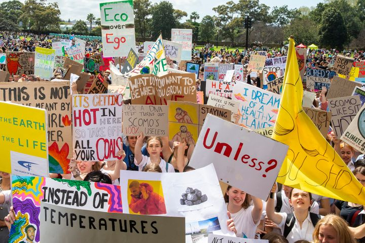 Thousands gathered in Sydney, many bearing signs decrying the government's support of fossil fuel and inaction on climate cha