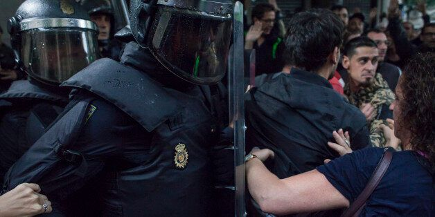 BARCELONA, CATALUNYA, SPAIN - 2017/10/01: People clash with the Spanish police 'Policia Nacional' after...