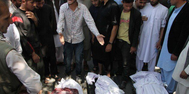 KABUL, AFGHANISTAN - JUNE 02: Protesters gather around the dead bodies of protesters after clashing with...